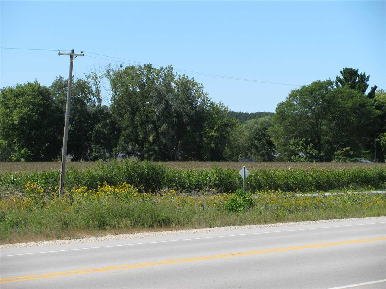 Parcel near Village of Black Earth with Hwy 14 visibility.  Various possibilities with either residential or commercial use.  Property borders up to Black Earth Creek.  Easy access onto Hwy 14 for your business venture.  20 minutes drive to Madison.