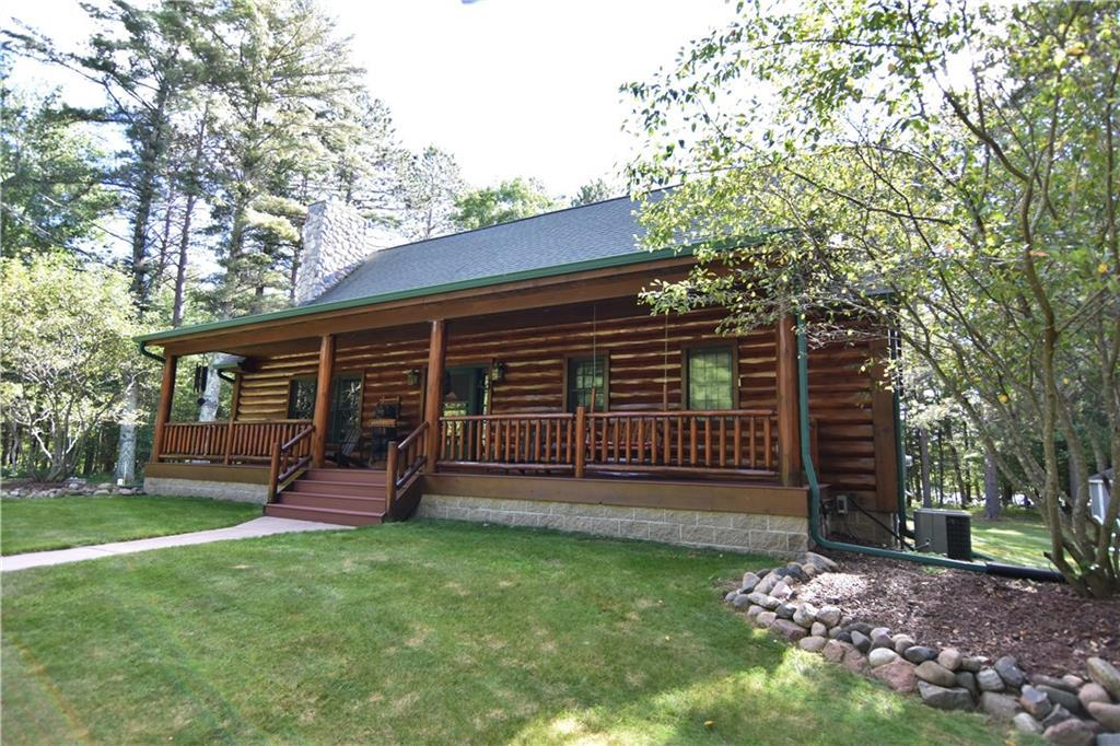This beautiful lakefront property offers a rare combination of over 30 acres of land and 415 feet of frontage on a serene Northwoods lake. Gorgeous log sided cabin with lakeside deck to enjoy southerly views of the water. Very nice approach to this clean and clear lake. Inside you will enjoy wood floors, 2 fireplaces, quartz counters, 9' ceilings, main level laundry, large walk in pantry, master with tray ceiling & large walk-in closet. Very usable fenced acreage provides you with endless options for outdoor recreation, yard games, raise horses, hunt, or build a large shed. 6 separate parcels give the option to subdivide. You will enjoy the abundant wildlife including deer that frequently visit the yard. Located on snowmobile/ATV trails, surrounded by many bodies of water.