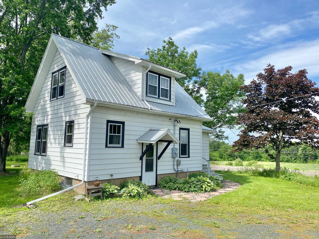 2 bedroom, 1 bath home on 10 acres. Metal Roof , new carpet, wood floors, 3 season porch, detached garage & chicken coop/barn. Cute as can be with lots of space in the country but close to town.