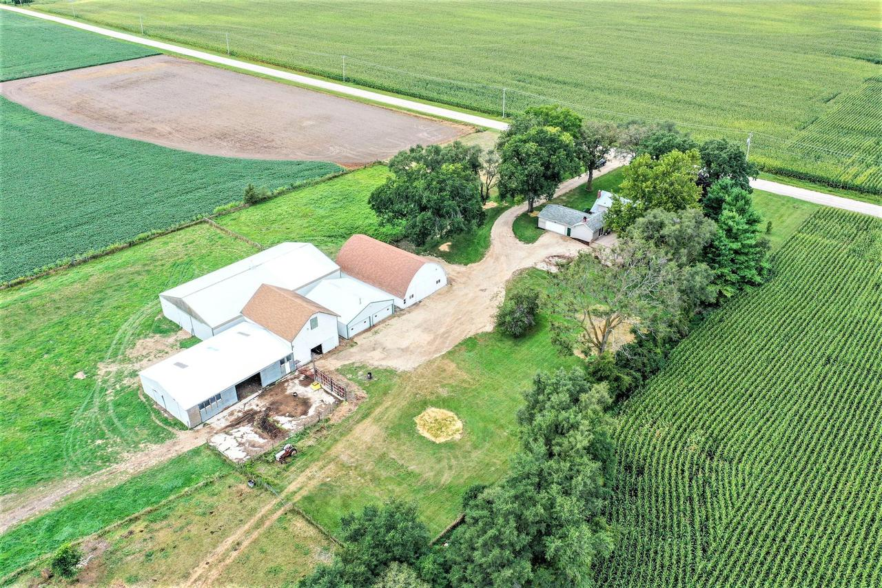 Finally YOUR search is over! You have found your hobby farm! Dreaming of a place for your horses, chickens, goats, sheep or cows? Well they are all sure to LOVE it HERE! This 22 acre farm includes 5 barns, wind break wall by pasture, hay storage, tack room w/water and heat, duck pond and riding arena with new sand!The house boasts an awesome deck and completely updated 3 bedroom 2 bath home with all updated utilities! Nothing to worry about here accept to love your time with your family and animals! Call today I promise you will not be disappointed! Per County Zoned A-1