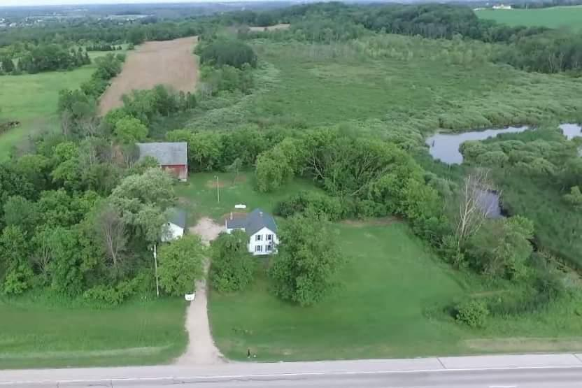 80 acres (2 parcel #'s) of multiple use Land with home, barn and 3 car garage. The renovated cozy farm house has 3 Bedrooms, 1.5 Baths and a bonus room and is move in ready!. The acreage consists of 17 tillable acres, forest, high woods, a pond, hills & wetlands. There are at least three beautiful home sites on the property. Great hunting land!!! Be sure to check out the drone video. This home also has an interesting historic background. It's Vertical log construction was a unique building method used by certain German immigrants.