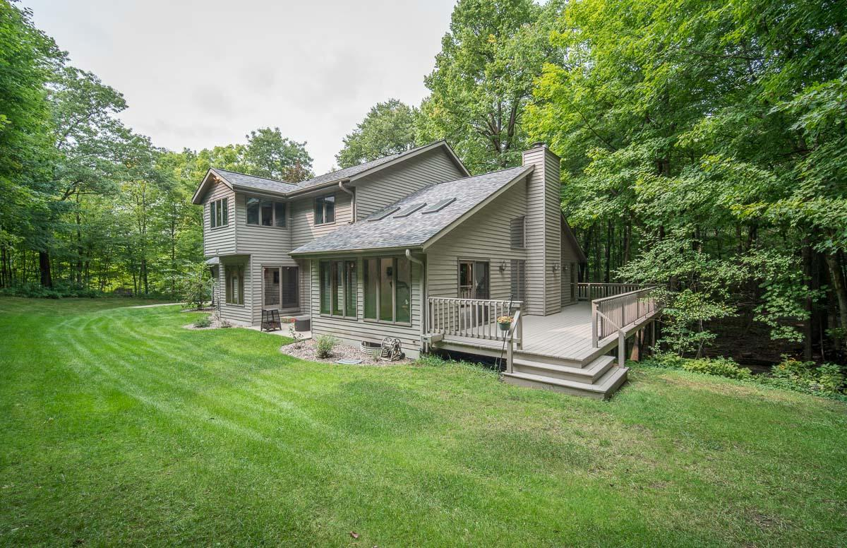 Here is an amazing opportunity to own a fabulous home in the private Scenic Moraine Parc subdivision of Slinger! This 4 bedroom, 4,000 sq ft home is settled into a 1 acre wooded lot with everything you would ever need. Eat-in kitchen with stainless appliances, granite countertops, breakfast bar, and newly refinished hardwood floors. Master bedroom has seating area, walk-in closet, and an amazing bathroom with dual sinks, soaking tub and glass block shower. Formal dining room has french doors that open to the grand living room with natural fireplace, vaulted ceilings, and lots of windows for tons of natural light. Relax in the 4 seasons room with skylights & hot tub, or kick back outside and watch nature on the patio or wrap around deck. Finished walk-out basement for endless entertainment!