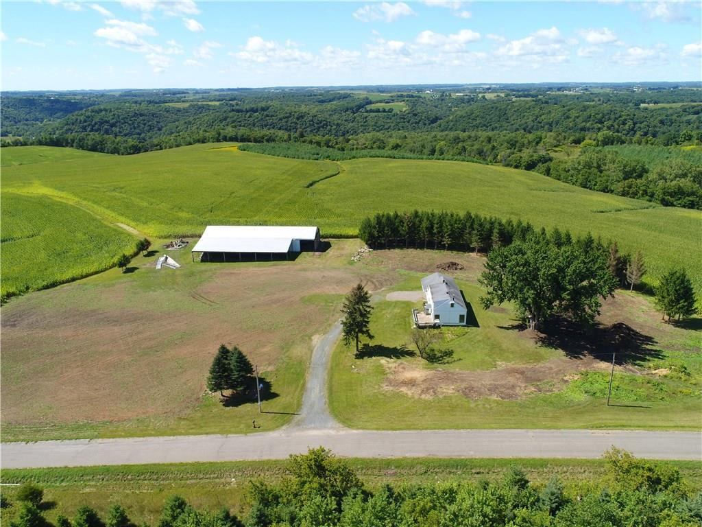 Breathtaking views from this five-acre hilltop property! Home is on a peaceful and private setting with south facing 12x21 deck, 4 bedroom, 1.5 baths, 2 car attached garage. Huge 42x120 pole shed with attached 30x96 lean-two for storage or rental income. Room for horses/hobby farm. Walkable or short ATV ride to beautiful Rush River! On ATV trail. Snowmobile trail nearby. Near unique Vino in the Valley restaurant. Needs some TLC.