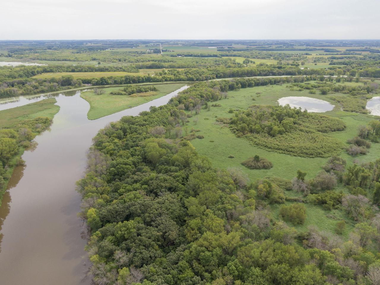 Hunters, looking for hunting land? Here's an incredible opportunity! Approximately 77 +/- acres of prime hunting land for deer, turkey, waterfowl.  Rural, low and wooded land is the right property for hunting. In the Mud Lake wildlife vicinity, nearby Chub Lake, an abundance of Crawfish River frontage, and an island all mingled in the area of a migratory flyway attracting a variety of seasonal birds.  This property is the only private Chub Lake frontage, approx. 1400+ ft. A hunter's dream come true. There is a building site that has been rezoned and approved for building. Perc test has already been completed.  Several acres are currently used for agriculture and the 2020 crops are not included in the sale price and grower must be allowed access to harvest 2020 crops. Multiple tax parcels