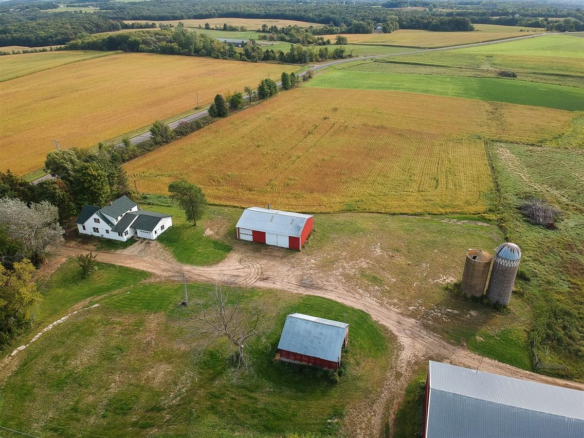 90 +/- acre hobby farm conveniently located just South of River Falls.  1968 construction, 4 BR, main level family room with updates which include 2007 furnace, 2019 roof, 2020 septic, 50 x 104 pole barn, 30 x 56 pole shed, 14 x 40 Stave silo, 2nd concrete silo and beautiful country views!