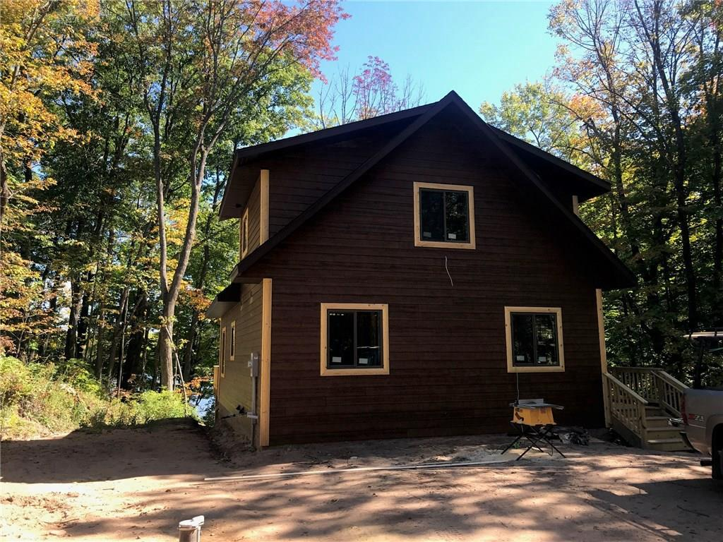 Construction has started! on this 3br/2ba Chalet !   When Cabin is completed cabin will have Main floor & loft will be finished (LL  Walkout/unfinished). Some features include: new appliances, screen porch, gas fireplace, & lakeside deck. Parcel is gradually elevated on a good size recreational lake that has great fishing. Minutes to Stone lake, Hayward, Birchwood or Spooner. Only about 2.5 hours to Mpls.  Buyers may have some options to choose some finishes before completion, may be additional cost) Pictures of Cabin will be posted & updated as construction progresses.!
