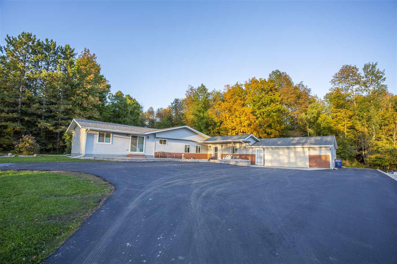 A beautiful outdoorsman oasis awaits its next owner! This sprawling ranch situated on a 17.97 acre lot features 3 bedrooms, 2 bathrooms, an attached oversized insulated garage, heated with LP gas furnace, and a huge 30x50 outbuilding, built in 2002 with 3 10x10 horse stalls. The main floor consists of more than 2000 finished square feet with a huge living room addition that opens to the back concrete patio and fire pit area and breezeway to the garage with cedar closet all completed in 2016. Stay cozy in the winter with the pellet stove in this space and bright windows allowing tons of natural light. Kitchen and dining room was updated in 2010 with cherry cabinetry, laminate counter tops and flooring, and a huge pantry! The master bedroom has vaulted ceilings, double closets, patio door, and attached en-suite with jetted tub, shower, and double vanity. Down the hallway you will find two additional guest bedrooms and a bathroom. The basement has another large living room for entertaining and an unfished storage room with laundry.,Also included is a back-up generator which allows only for a 7 second lag in power if you ever experience power loss. This home is located in a gorgeous location with tons of wildlife and no light or sound pollution, within miles from Hatley and highway 29 access. SO many updates (see associated doc?s for complete list), this home is truly move in ready. An additional 25 adjoining acres is available for sale, but not included in this list price. Contact the listing agent for pricing on additional acreage) Schedule a showing today! Original address is N873 Nazda Rd.