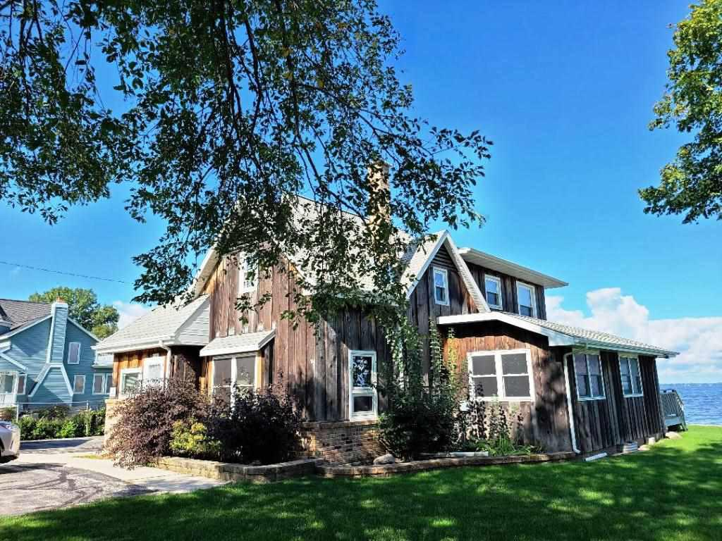 OVER 200 Ft of Lake Winnebago frontage!!!! Picturesque view on a gorgeous lot just east of Sunset Shores! Stunning 28x30 boathouse (2003) plus 2 1/2 car garage. The house has 2500 sq ft that is waiting for your remodeling ideas! It has 3 bdrms, 2 bths (one is updated), Big living room w/frplc, formal dining, 3 season room and a family/laundry/mechanical room! This is a one of kind property!