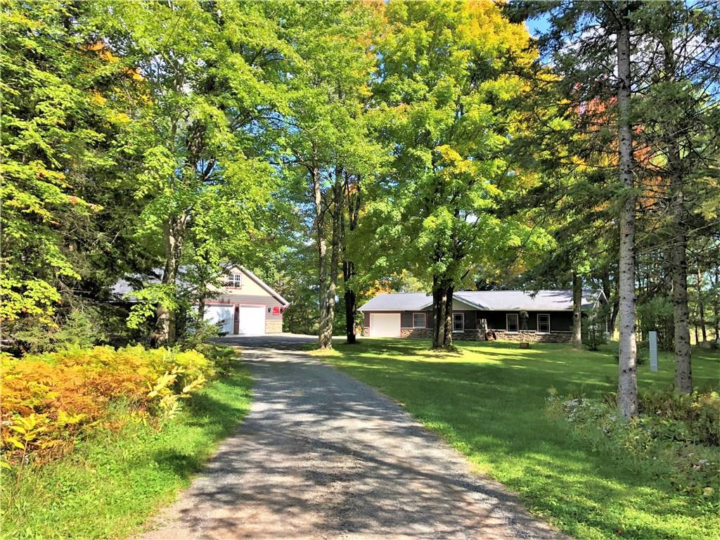 Serene Up North Retreat ready for your enjoyment! This 2 Br, 1 Ba home 6 miles from town sits on 30 wooded acres w/ a trail system overlooking +/-1000 ft' of Deer Creek frontage. Abundant wildlife surrounds you! Home was gutted and remodeled in 2015 w/ high-end materials: knotty pine interior, reclaimed barn wood cabinetry, stamped concrete & ceramic flooring, Quartz counter tops, modern lighting, gas stove fireplace, Anderson windows, & more! Att 1-car garage, 40x40 det garage & 16x24 shed.