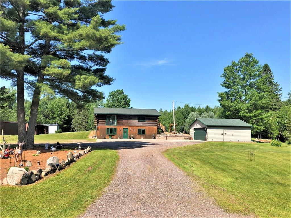 Northwoods paradise -- 2 BR, 2 BA log home on 120 acres of wooded land w/ trail system, 5-acre field, 2 hunting stands & small creek. Open concept main living area, snack bar, walkout to new deck & backyard patio, master BR w/ full BA. Lower level has tongue & grove interior, family rm, 2nd BR, full BA, laundry rm. New roof 2010, outdoor wood stove 2010, septic tank 2016, various other major updates completed. Flower/vegetable gardens, several apple trees. 2-car det garage, 55x13 & 24x14 shed.