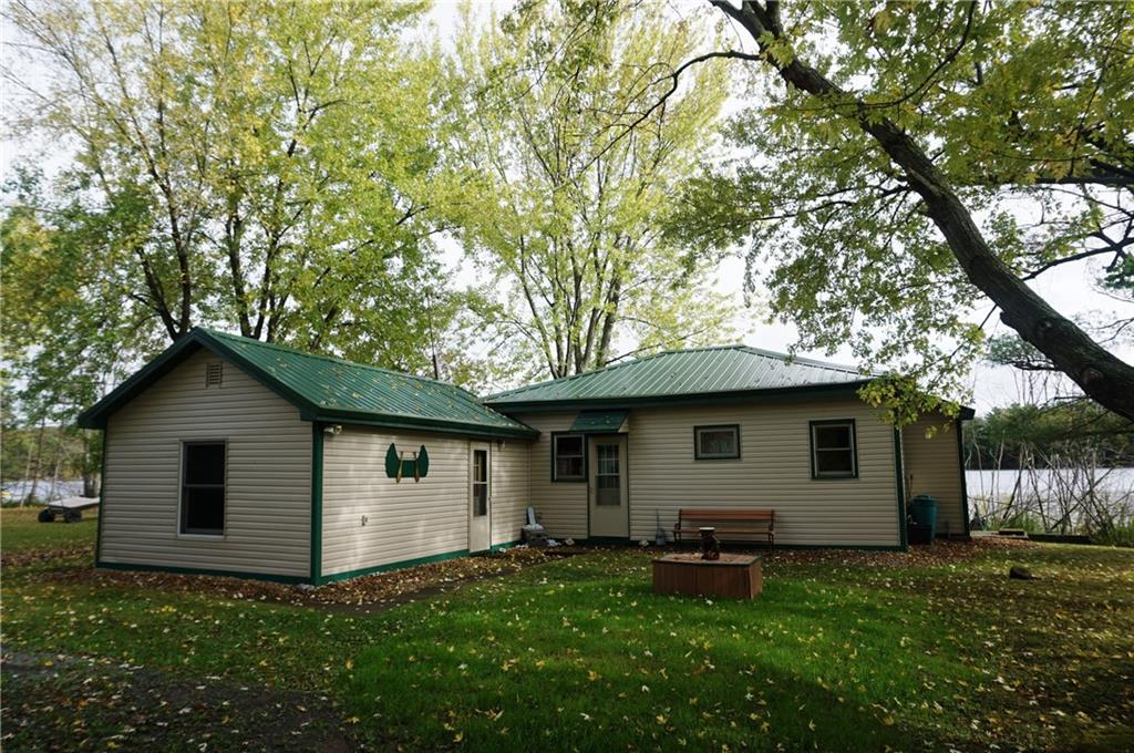 Cute & affordable year round cabin offers a very private surveyed setting w/approx. 73 feet of Mid-Pine Lake waterfrontage, dock & pontoon! Rustic, welcoming open concept interior boasts Knotty Pine walls, new laminate wood floors throughout (2018) and fabulous views of the lake! New LP furnace (2018); 100 AMP breakers w/some fuses; sand point well w/new pump (2016); 2000 gallon holding tank; 8x20 canvas 'garage'; 8x10 & 8x8 utility sheds. Hurry and you can still enjoy this retreat this fall!