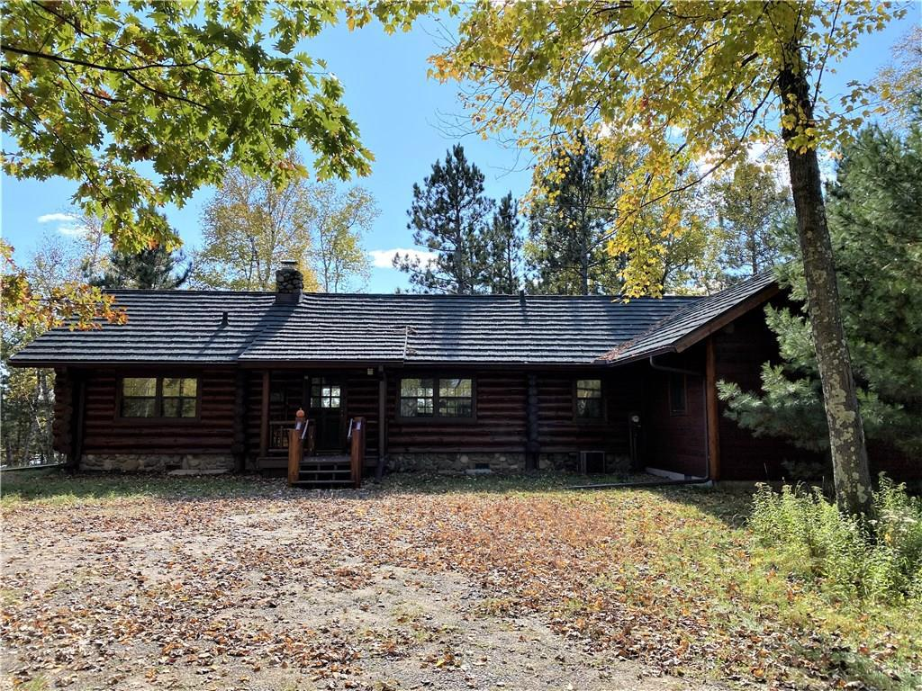 This unique log home sits on the North Shore of Callahan/Mud Lake on a peninsula with expansive views and no other homes in sight. The property is densely wooded and very secluded with over 1400' of lakeshore. The log home features 2 bedrooms and 2 baths, loft, 2 screen porches, lakeside deck, spacious living area with a floor-to-ceiling stone fireplace. The cabin has unique southern pine flooring, custom kitchen cabinets and German built dining table/seating. Detached garage includes additional living space above w/ 1BR/1BA & deck overlooking the lake. Net acreage is 11.55 which excludes area under OHWL of Callahan Lake. Total acres is 36.18 which includes area under OHWL. Includes two addtional lots on which to build. Furnishings are negotiable.