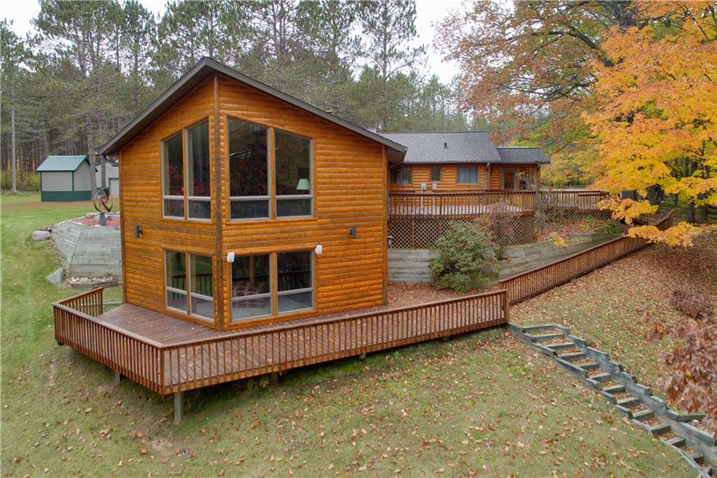 Larson Lake Hayward ? Peaceful, private, pristine, One-Of-A-Kind Northwoods Retreat surrounded by Cheq Nat'l Forest. Breathtaking views, approx 1700? of lakeshore, 32 ac of mature pine & hardwoods. Custom built 6,000 sq ft home with 5 BRMS, 3 Full/2 half BA. Bright, airy dream kitchen w/numerous cabinets, granite countertops, center island. Ash flooring thru out, open concept w/spacious living/dining/kitchen combination. Floor to ceiling windows overlooking lake, vaulted ceilings & skylights. Walk thru the French doors to a cozy great room with 2-sided stone wood burning fireplace. Large Master BR, 3 guest BRs on main level plus finished LL w/entertainment room, wet bar, office, guest BR with private BA, storage rooms & mechanical room. Various levels of decking for your outdoor entertaining. 2 pole/garage buildings & 2 storage sheds complete the package. Come & enjoy all the Northwoods has to offer on your own private estate.