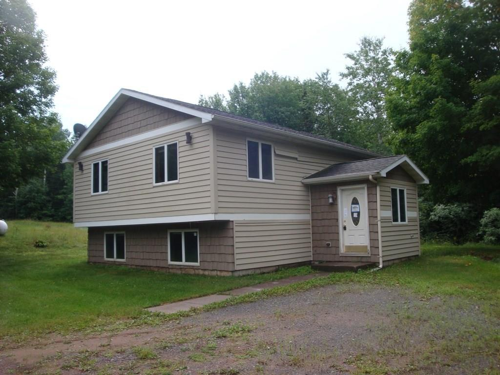 Great property with this split level home to finish to your liking. 4 plus bedrooms with two full bath. Nice open kitchen, dining, living floorplan. Two car detached garage near the home and another garage for additional storage with potential living quarters or additional workshop. Hear the water trickling with the Amnicon River flowing