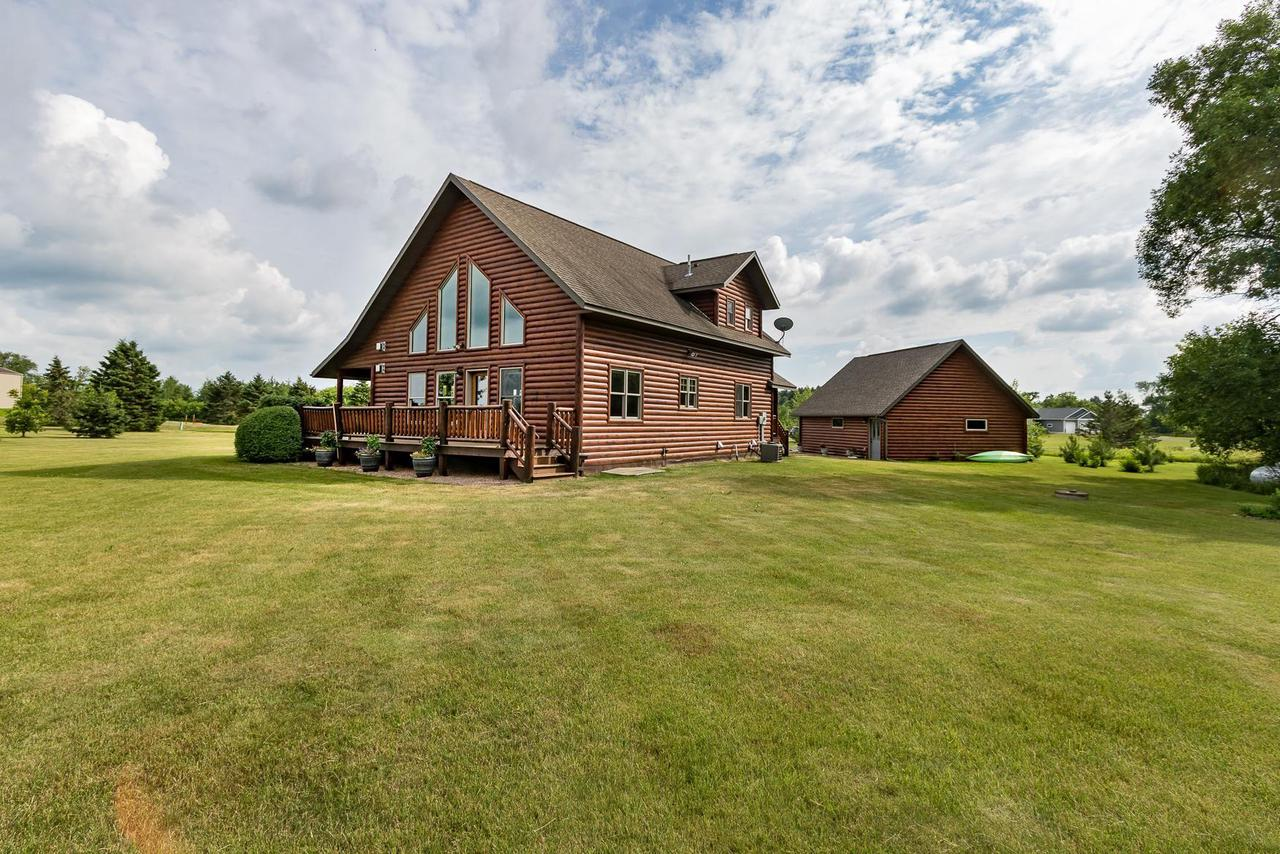 This beautiful, one-of-a-kind log home has been very cared for. The private country setting is just what many people seem to want. It's hard to find, let alone in this kind of shape. The open yard is host to a log home and setting that definitely unique to the area. Built just a few years ago, this home has always been well maintained. It offers one level living and easy access to the major highways for commuting. The log home has many great features such as: dual fireplaces, tile floors, hardwood floors, vaulted ceilings, huge windows, giant family room, a full length porch and a garage with the loft for extra space.