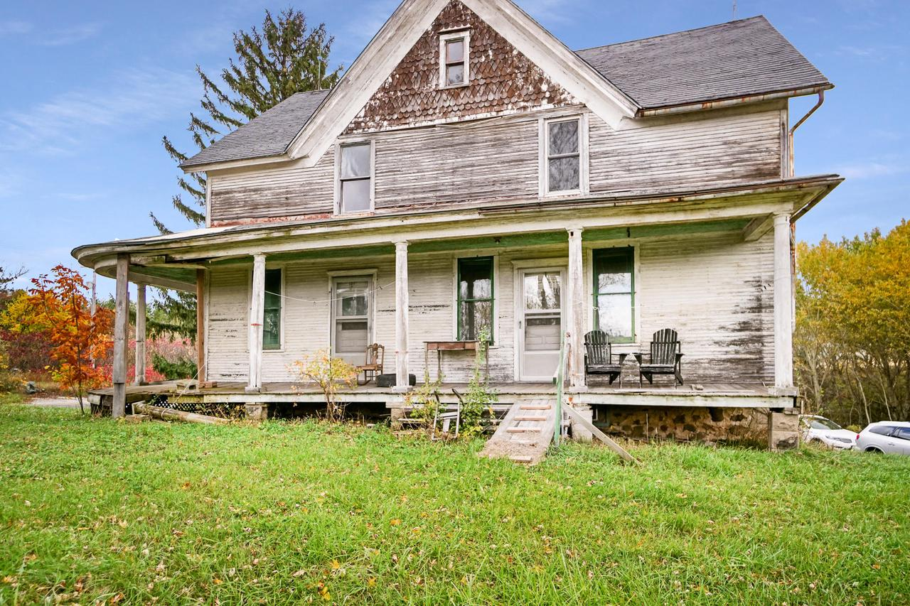 Fantastic opportunity to give new life to this serene 10 acre farm featuring a large 5 bedroom farmhouse in need of a complete rehab. Inside, it currently offers extensive hardwood flooring and beautiful wood trim! On the property there are multiple outbuildings including a 36'x72' barn with a new metal roof and electric service. Various other buildings include a 18'x24' lean to, 18,x54' shed, 18'x26' granary, and three more buildings! Each building would be great for storage, or revive and repurpose to make them something special! This unique space would make a wonderful event venue or family homestead, and seller has conditional use permit already in place for the house! The opportunities here are endless! This property is being sold as-is.