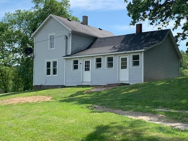 Hobby farm with 105 acres and a nice mixture of tillable, pasture, and woods. Older 3 bedroom, 1 bath home. Approximately 50 acres tillable rented at $150/acre with 35 acres pasture, and 20 acres wooded. Home is rented out $600/month. The outbuildings are in need of repair. Sellers will divide and sell the buildings with 3 acres at $95,000.00 or with 15 acres (left of driveway) at $145,000.00. Easement to previous owner to access back forty of woods.