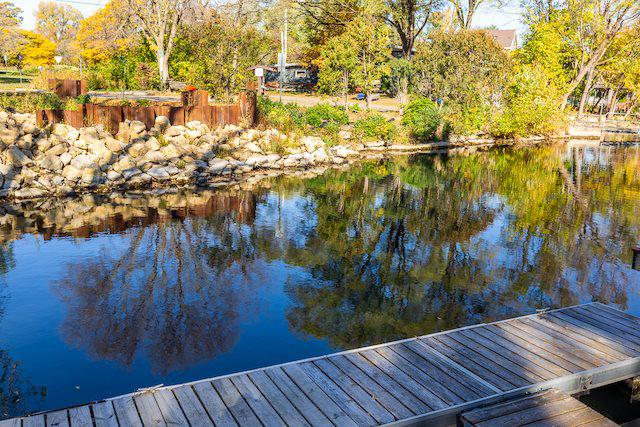 This 2 year old 2 story has a full basement and frontage on Spring Harbor Channel of Lake Mendota with a 24 foot pier.  The open kitchen living area features a fireplace with stone reclaimed from the original house.  The kitchen has a large island, quartz counters, a Wolf stove and high quality cabinets.  The 1st floor master suite has a walk in closet and the master bath features subway tile.  The 2nd story has 3 bedrooms, a full bath and utility room with washer & dryer.  There is a full basement with a 7 foot ceiling for storage or maybe a wine cellar.  The garage features slatwell panels.