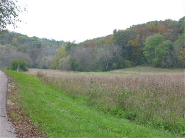 Picturesque setting on dead end Town Rd.  Hillside building site tucked away on 39 acres, mostly wooded with hilltop pasture, accessible with field road.     All within 25 minutes of Madison.