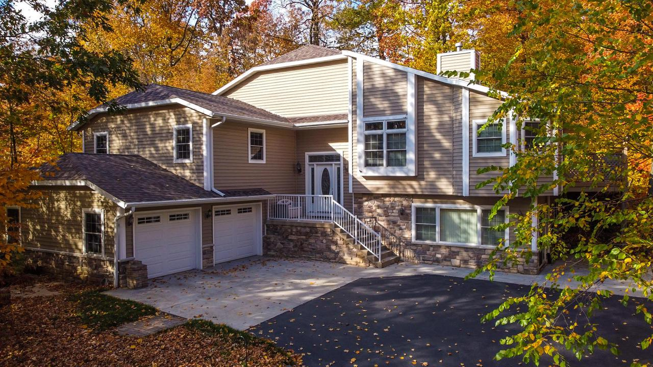 Looking for something that will bring the WOW factor? Well this custom built unique multi-level home will not disappoint. Surrounded by trees and wildlife, this amazing home offers a 2 story foyer featuring dura-ceramic flooring & 2 large closets. On this floor you will find the laundry room, full bath & music room. The Kitchen/Dinette offer beautiful hardwood floors, pantry, snack bar, oak cabs, vaulted ceiling & transom windows. The Living Room highlights gorgeous transom windows, patio door, vaulted ceiling & gas fireplace. The Master Suite has custom walk in closet, door to private deck & tiled shower stall. Plus a lower level walk out Family Room. Highlights include: Anderson windows, rounded corners, wrap around deck, 6 panel oak doors, wooded lot & play fort, lofted ceilings & more!