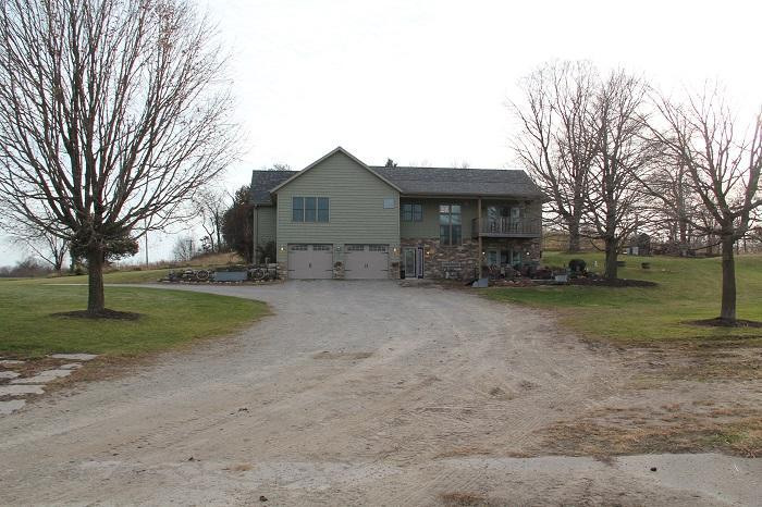 Country living and a business opportunity awaits this 36 acre farm.  Zoned agricultural, taxes are affordable including a like new 2,192 square foot, 3-4 bedroom, 3 bathroom, spacious 2+ car garage, walk out basement to a patio, custom built raised ranch home. 25 stall horse barns, indoor and outdoor horse arena, pasture land, cropland, and woodland.
