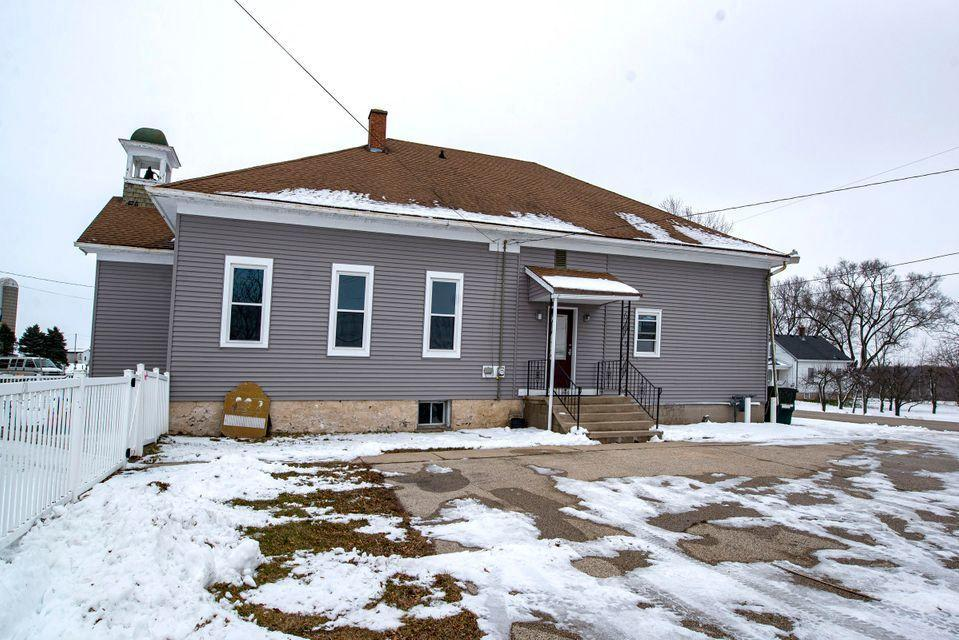 Here is your opportunity to own your own school house. Zoned B2, but may be able to rezone R2 single family. 2454 sq feet to work with. Main level consists of: Room 1- 29x13 w/ HWF, sink, bubbler, BIBC, Child 1/2 BA. Room 2- 29x22.5 HWF, BIBC, Childs 1/2 ba. Room 3- 21.8x17 with a 10.4x8 kitchen, Laminate wood floors, 1/2 wall to Room 4- 21.8x17 Laminate wood floors, bubbler, and access to a 7x6 adult 1/2 ba. Basement features plenty of storage and a 1 stall/1 urinal boys bath, and a 2 stall girls bath. Fenced in side yard and fenced back area. Still has the bell in the Bell tower! Plenty of parking, call for your private showing today. Updates: Windows and siding.
