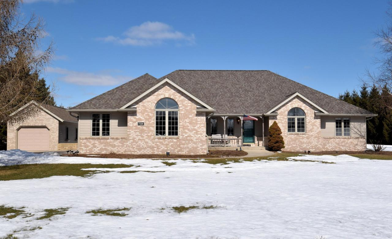 Fall in love with this open-concept Ranch located in a rural setting on almost 3 acres.  Large Living/Dining area and Kitchen offer great space w/ plenty of natural lighting. Granite counters, tile backsplash, custom Oak cabinets & flr in Eat-in KIT. You will be amazed at the counter space! SS appl incl. Master Suite w/corner jacuzzi and WIC.  Finished LL with  LG Rec Area,  Built-in Bar, Flex Rm and Full BA! A perfect place to entertain outside or in! 14'x30' Det GA w/3 Season Rm. Updates incl: New Roof & Gutters '19, Furnace, '14, Epoxy GA flr '18 & More.  Seller to assist w/carpet replacement on the main flr - $3k credit @ closing! No HOA dues! Peace of mind with HMS Warranty. Home offers A LOT more than you would think is possible at this price!