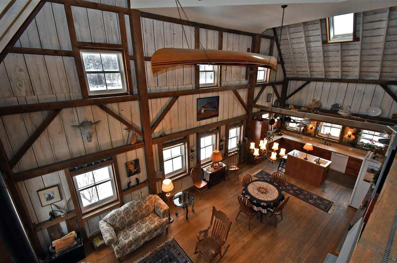Rare Opportunity!  1914 Historic Barn, now converted to Beautiful 3 Story Home offering 32 Ft. Ceilings and over 4200 sq. ft.; has hndicapd access in-law apt.; Also 1850's Farm House (Cooksville Farmhouse Inn) - real income producer approx $40K annual income; And a 28x40 party barn. Perfect for family reunions, retreats, music gigs, weddings -- could provide serious xtra income. @9 acres w/ springfed stream, trails, native prairie, 3 Bridges, pasture.  60x60'  Pole barn is one half spray-foam insulated, heated,  in. pine paneled banquet room and/or workshop;  other half is timber frame chicken house or tack room, stalls for animals and storage., Working Windmill, milk house conv. to Tiny House. See www.Cooksvillefarmhouseinn.com. This is a real money maker with endless possibilities.
