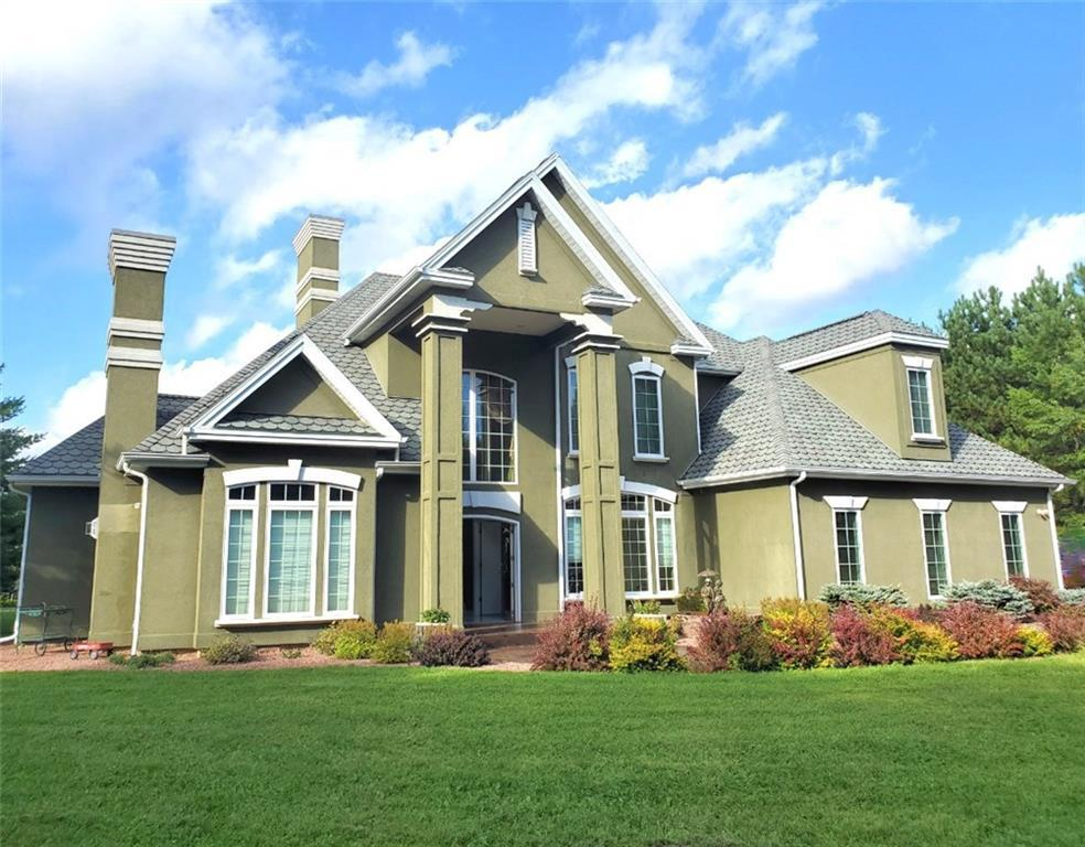This beautifully designed distinctive home sits on 16.18 acres in the middle of a serene pine plantation, just down the road from Spider Lake and Spider Lake Golf Course. A grand well maintained home with 5bd, 3.5 baths, hand painted walls,upgraded finishes,  and a gorgeous 2 story marble fireplace. Enjoy a view from every room.Outbuildings:heated attached garage, 45x90 6 stall horse barn/workshop and a 60x80 pole building. Unbelievable access to the world-renowned Birkie and CAMBA trails.