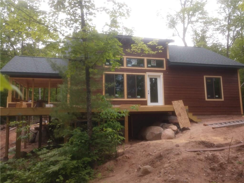 New construction underway on Pearce Lake! Step into this newly built home set in the quiet woods with low elevation to this serene lake. Home is the perfect size with 3 bedrooms, 2 full baths, loft, open concept main floor, lower level family room and 3-season screen porch. Lakeside deck with SE views. At this point buyer has opportunity to choose many interior finishings.  Estimated completion is fall 2020. Landscaping including rock border, gravel drive and seeded lawn included.  Some photos are of similar building projects ONLY and not a representation of the current progress.  Note remarks in photos.