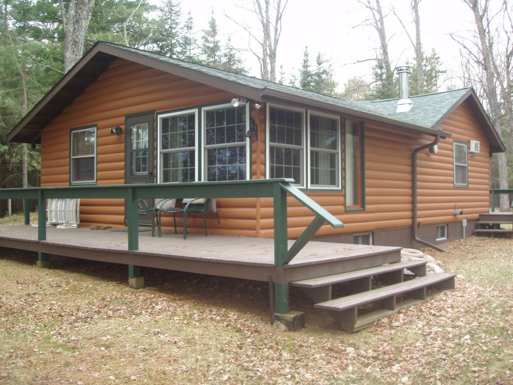 (263/PB) Pike/Round Lake Chain. Four connecting lakes. Over 1,900 acres of water. This 2 bedroom 4-season cottage/cabin is situated on a heavily wooded 1.3+/- acre parcel with 115+/- feet of sandy frontage on Pike Lake, one of the area?s larger, most sought-after fishing and recreational bodies of water in Northern WI. This well-maintained, neat as a pin cabin features a living room with free standing woodstove, galley-type kitchen, dining area, bath, LP gas wall furnace and electric heat. Basement, 2-car detached garage, drilled well and conventional septic. Located between Park Falls and Minocqua off Hwy 70 on Everbreeze Lane. This area is surrounded by thousands of acres of Chequamegon National Forest lands which provide all the up north amenities for you to enjoy year around recreational pursuits. Price right. Don?t miss this opportunity. Asking $209,000. 2019 taxes: $2,957.89. (11-39N-3E)