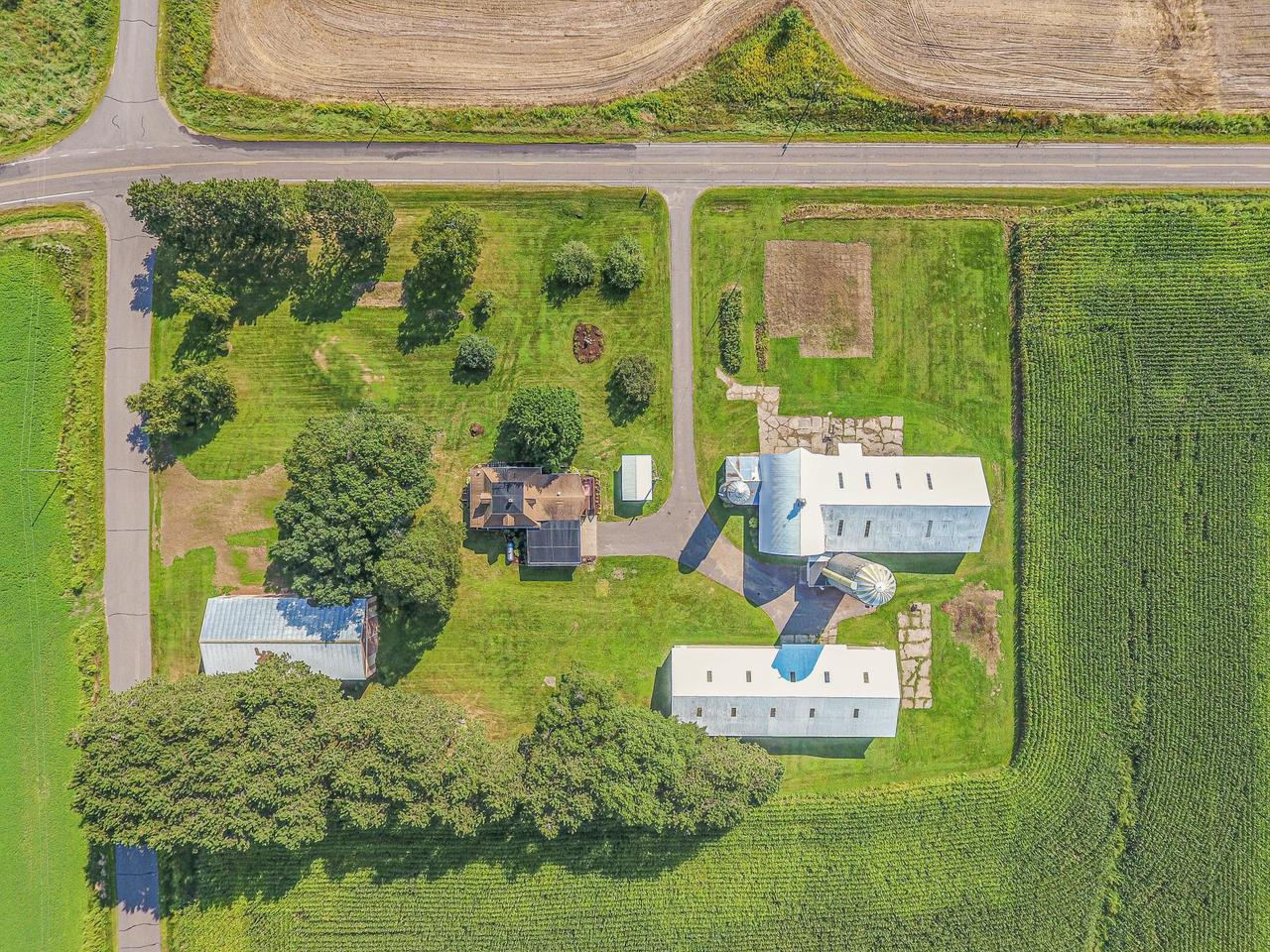 Historic stone farmhouse on 5 acres in Chippewa County. 4 outbuildings w/16000+ square feet of storage for toys, animals, toys. Perfect for business or hobby farm, or country living. Low taxes, all new flooring/paint, apple trees, raspberries, ATV trails nearby, HUGE kitchen, formal dining, Main laundry, attd garage, hip metal roof barn, two pole sheds & add'l storage. Deck, porch, stunning views.