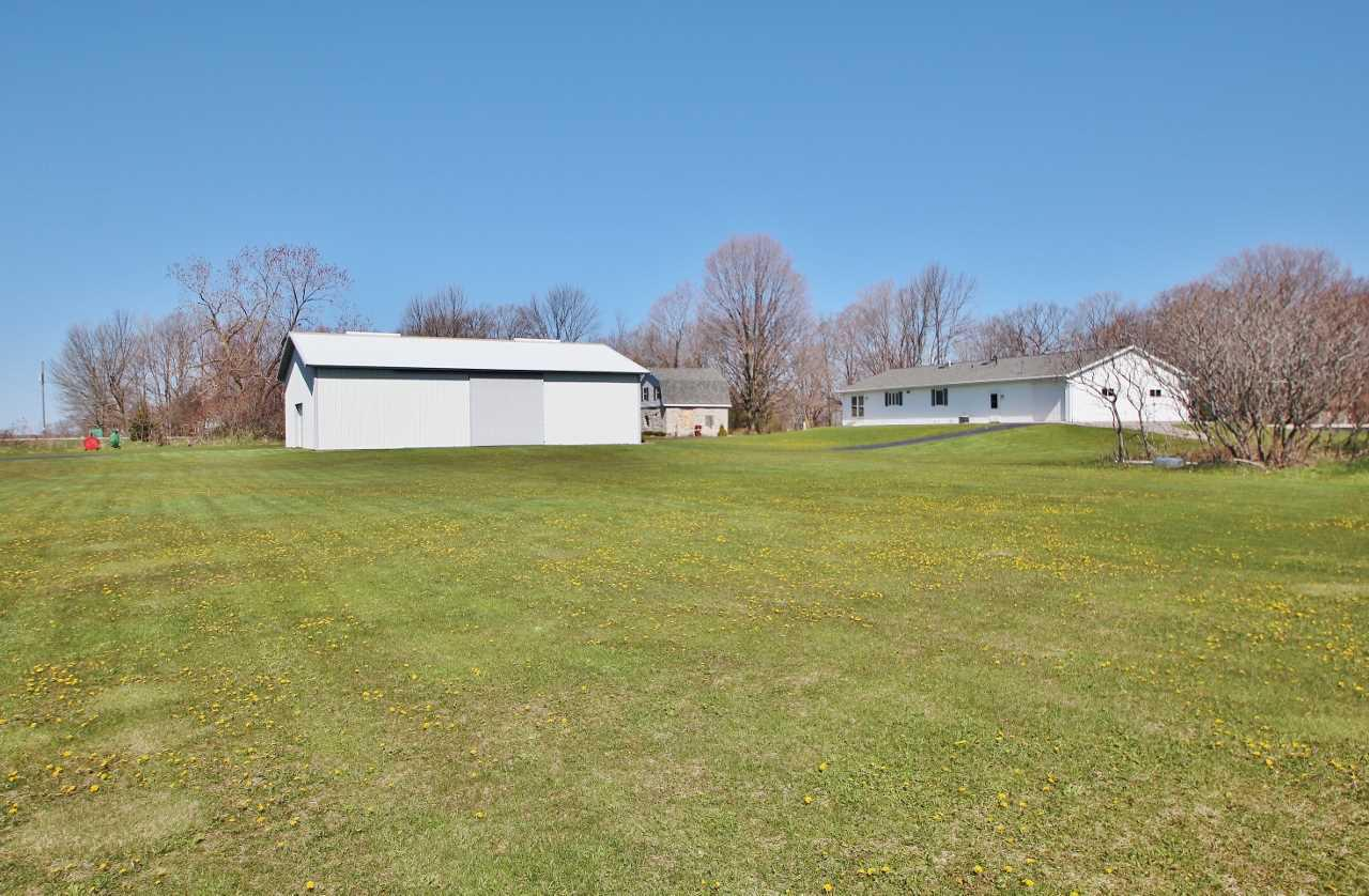 Ever want to live on your own orchard!? 3bd, 2ba 2003 Ranch home sits on 40 acres in the Town of Gardner in Door County. Home has kitchen island, pantry, tile floors, 1st flr laundry, master suite, central vac, & more! Mature cherry trees are currently harvested each year by people that love to pick cherries. 30' x 36' attached garage plus a 40' x 60' pole building for all your toys & equipment. Bonus: 100+ year-old farmhouse currently used as storage & on the historical register would be perfect to renovate as part of the charm of this property. 60 years goodwill and customer base.