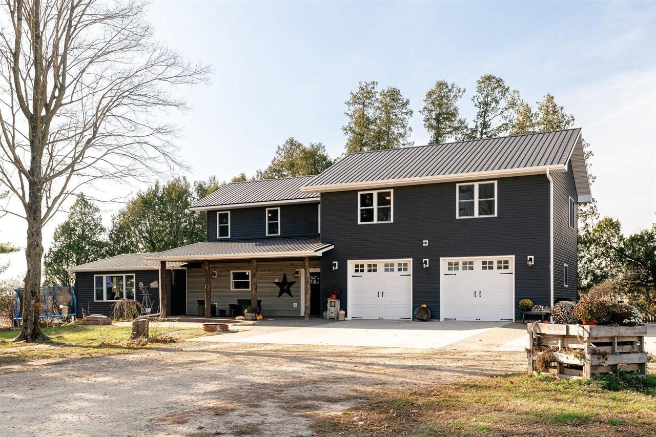 The opportunity to own an attractive country property w/ a touch of class has arrived! Minutes from town you will find the perfect farmette setting w/room for animals, gardens, outbuildings, & a NEW 40X64 pole shed. The private pond gives year round enjoyment creating a winter wonderland on your own skating rink. The 2 yr old home, with 2.5 car heated attached garage, features a spacious floor plan w/ high quality finishes including Amish made doors & cabinets, stainless steel appliances, solid surface flooring, & a commercial grade HVAC system. Natural light fills both levels of the home w/ beautiful Driftless views out your kitchen & living windows. Schedule a time to take a closer look & make this property yours, in 2021! A must see!