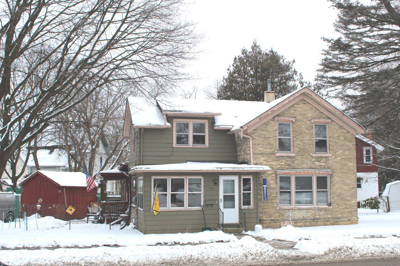 Looking for farrmhouse charm, but still want to be within walking distance from downtown? Don't let this opportunity pass you by! This two story, three bedroom, two bath, brick home is priced to sell! Enter your new-to-you home through the bonus three season porch, with hardwood floors throughout and adorned with arched passageways between each room. The kitchen boasts custom cabinets and a large pantry. Seller is additionally offering a one year home warranty!