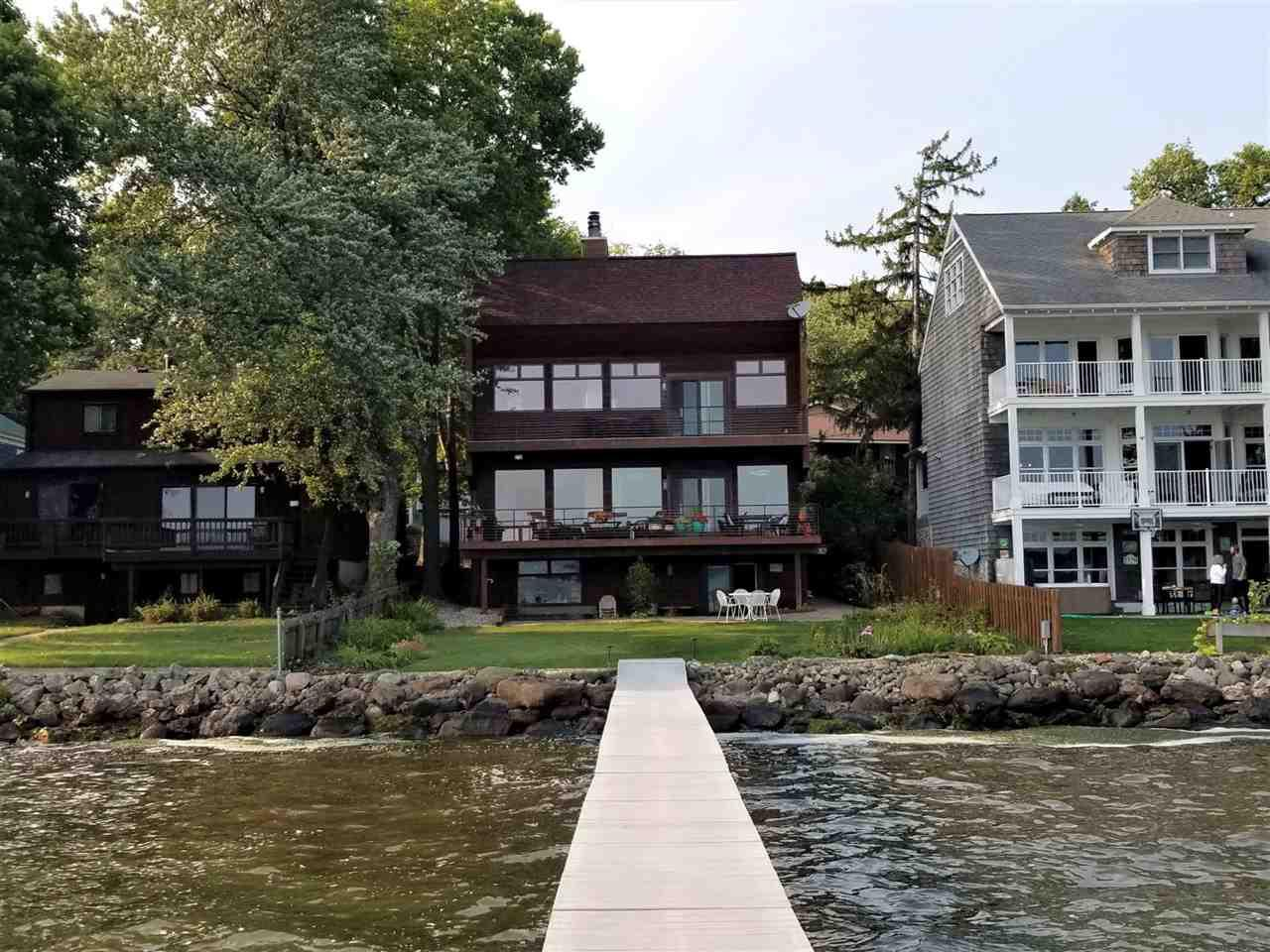 Don't miss your opportunity to enjoy Lake Living! 50 Ft of Lake Mendota frontage located in the desired Middleton-Cross Plains School District! Home features a custom contemporary design that just keeps going. Over 4,500 finished SQ FT of living space. Enjoy 3 levels of Lake & Capital views! Bright Chef's Kitchen has abundant counter/cabinet space w/breakfast bar, pantry, Island, Sub-Zero Refrigerator, Viking Range, Double Ovens & the Wine fridge is included! Master bedrm has vaulted ceilings & skylights w/full bath & access to deck. Lower level adorns kitchen, wet bar, office, exercise/craft/game rm & walkout to the brick paver patio. Large windows w/Southern exposure enhances the passive Solar heating system in home. 3 fireplaces, two-car attached garage & workshop. And More- Must See!