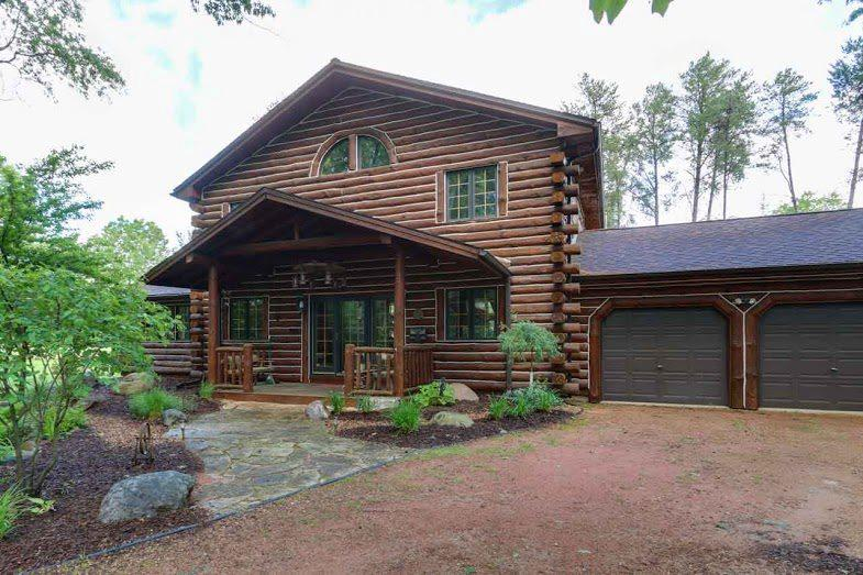 Picturesque Log Home in a private waterfront community. This 3 bedroom 2 bath log home is being sold completely furnished right down to the water toys! You'll enjoy the welcoming 2 story covered front porch. Master bedroom with french doors to the wrap around deck overlooking the professionally landscaped lawn & custom built firepit area. Cozy up to the floor to ceiling stone fireplace in the 2 story great room on those cold winter nights. The loft offers you extra sleeping & gather space for your family & guests. Attached 2+ car garage is even heated. Amenities included are private marina on Castle Rock Lake, pool, tennis courts, club house, basketball & playground. Fish, ATV, snowmobile, swim & boat right out your door. 4 Seasons of Fun in Half Moon Bay on Castle Rock Lake.