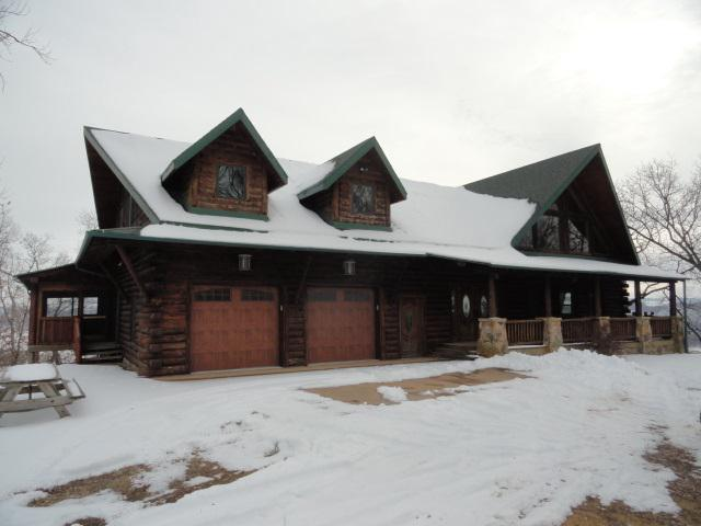 Stunning custom built log home on 4.6 acres with panoramic viewsof the Grant County & Buena Vista Iowa Bluffs, overlooking the Mississippi River below.This is a full log 6100 sq ft, custom built beauty where size and open spaces were paramount in its design. 4 large bedrooms, 4.5 baths. Gorgeous wood floorsand wood accents throughout. Enormous stone fireplace in the great room. Very spacious kitchen, all appliances included. Large & private master suite. Sizable loft overlooking the great room. Full walkout lower level w/htd floors ready to be finished for additionalliving space.Large deck & patio area below. 2 car htd garage. 296 acres of DNR land borders theproperty. Scenic Hills development also has 40 acres of recreational land for bow hunting, atving, hiking, etc.